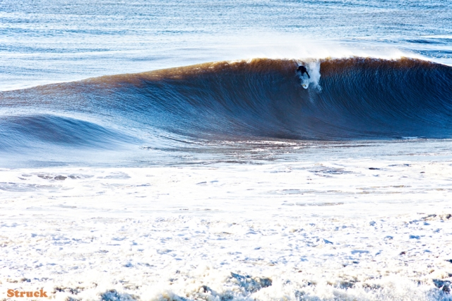 PJ Raia surfing big waves in New Jersey.