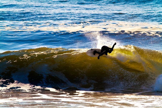 surfing backside. going right in new jersey. goofy foot surfing.