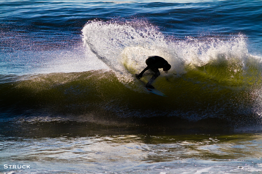 brian parnagian surfing in new jersey. jetty. backside surfing. backside turn. goofy foot.