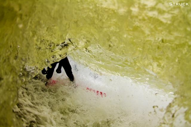 pj raia surfing in new jersey. fisheye photography. fisheye water photography. new jersey surf photographer. swimming.
