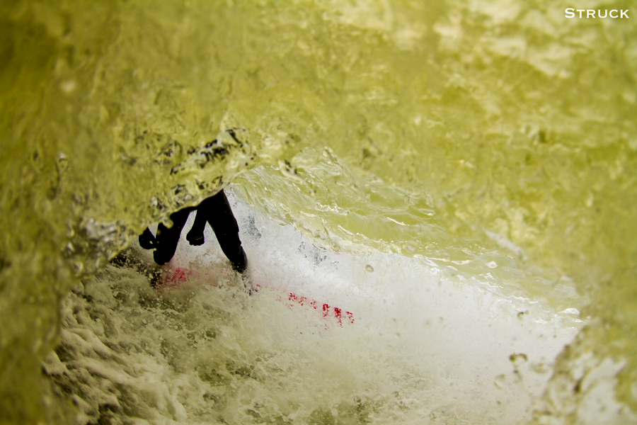 pj raia surfing in new jersey. fisheye photography. fisheye water photography. new jersey surf photographer. swimming.