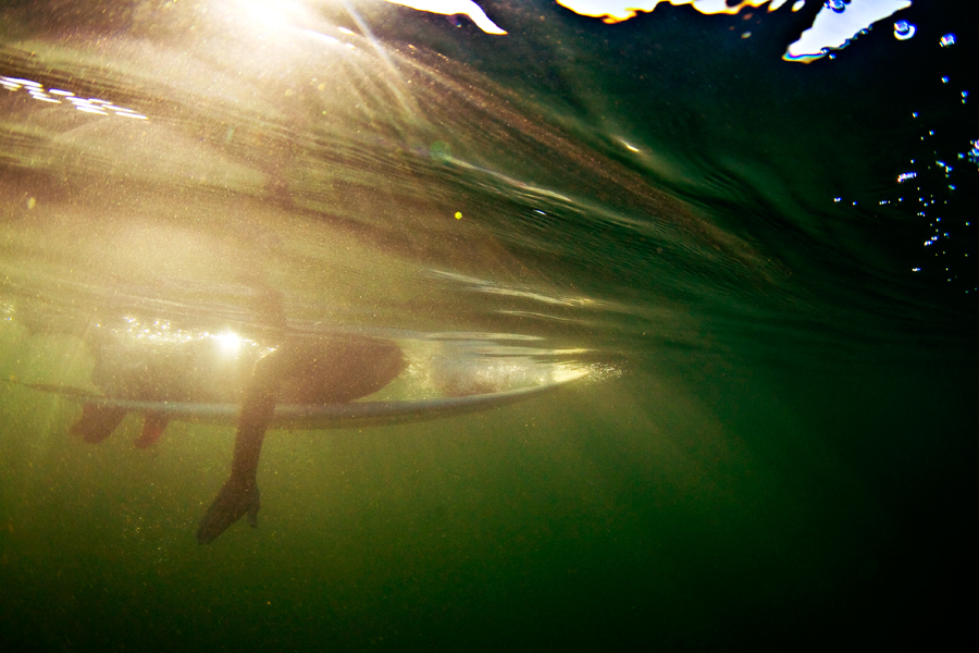underwater photography. underwater surf photo. duckdiving. central america. under the waves. pacific ocean. paddle out.