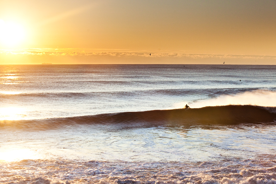 sunrise photo. new jersey surf. surf photography. surfer on a wave. surf photographer. surf photography. lifestyle photo.