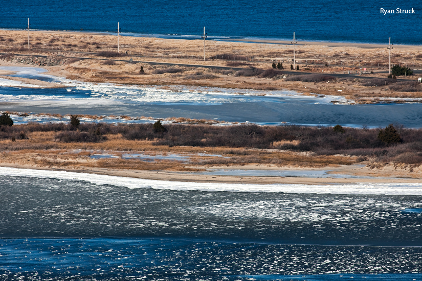 frozen. cold photography. snow photo. shrewsbury river frozen. sandy hook bay ice. winter beach. sand dunes. aerial photography. new jersey aerial photographer.