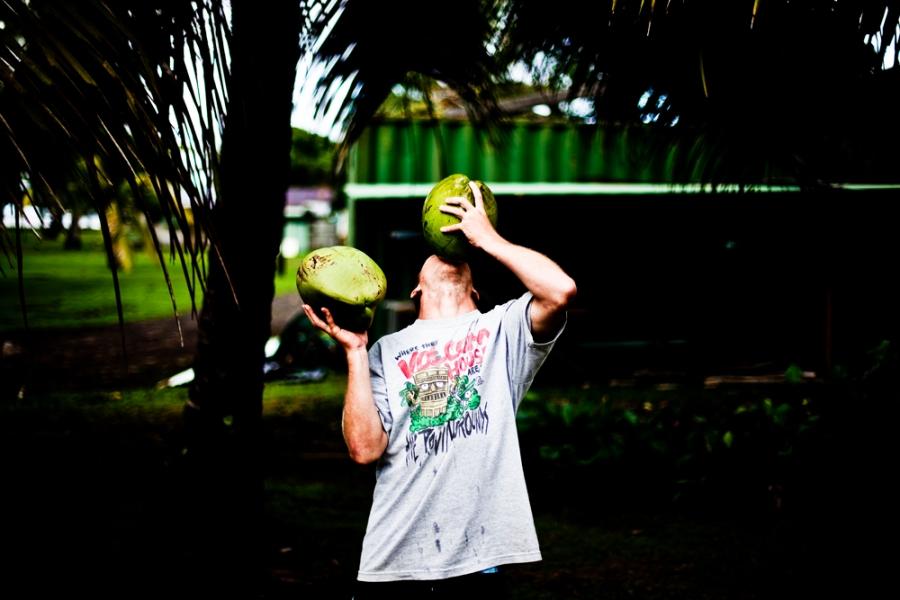 surf trip. surf lifestyle. drink coconut. surf lifestyle photographer. gathering. surf. image. travel photographer. portrait. destination.