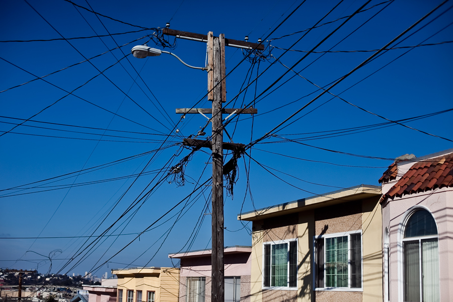 golden gate bridge. california. san Francisco. power lines. small street. small town. travel photographer. editorial. energy photo. environmental photographer.