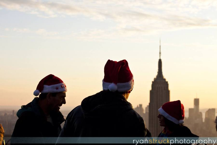 santa hats. holiday season in new york. empire state building on christmas. tall buildings. architecture photographer.