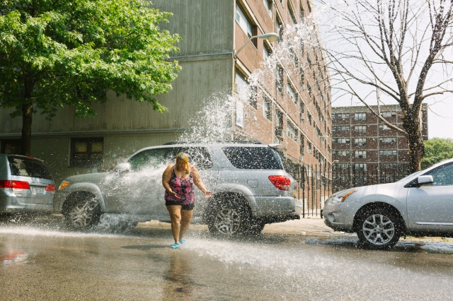 residents in brooklyn open up a fire hydrant to cool down during a new york heatwave